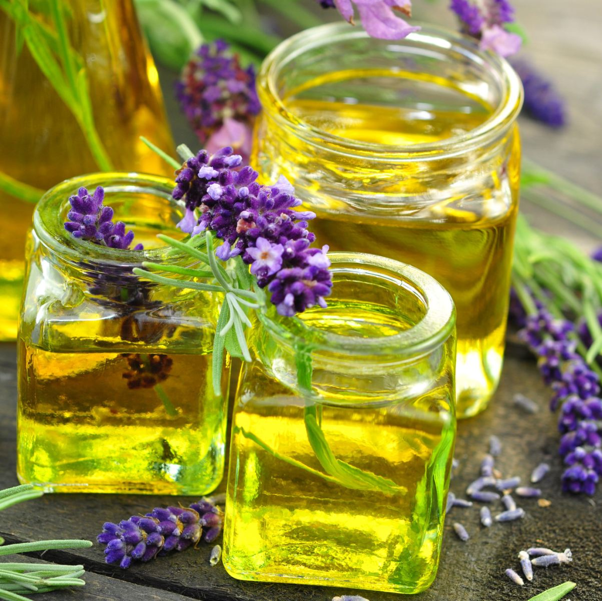 jars of oils with flowers